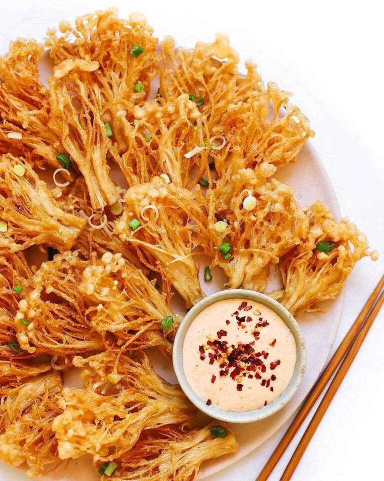 Crispy Enoki Mushrooms with Spicy Mayo recipe displayed on a plate with chopsticks.