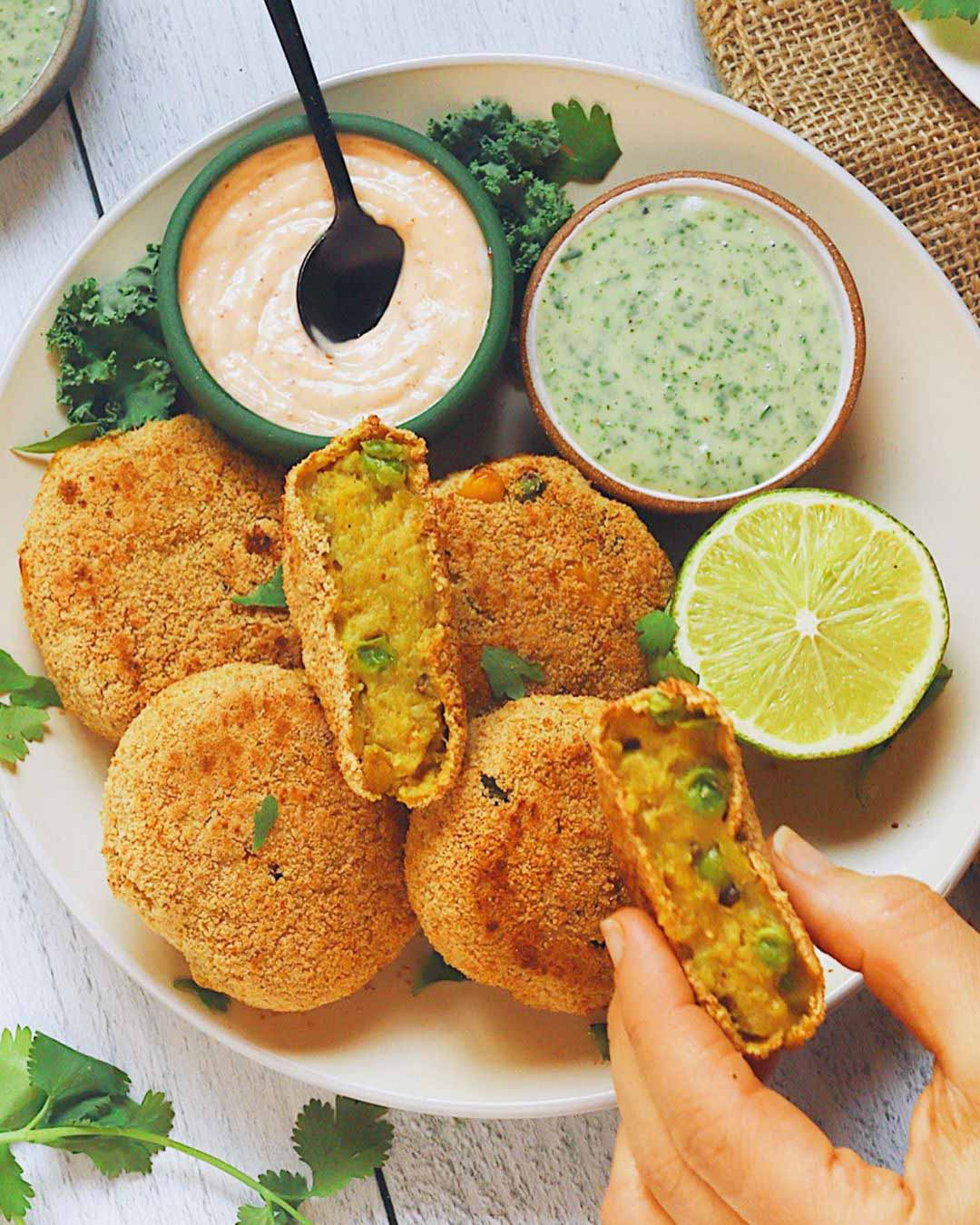 Aloo Tikki (Potato Croquettes) recipe served on a plate with dips.