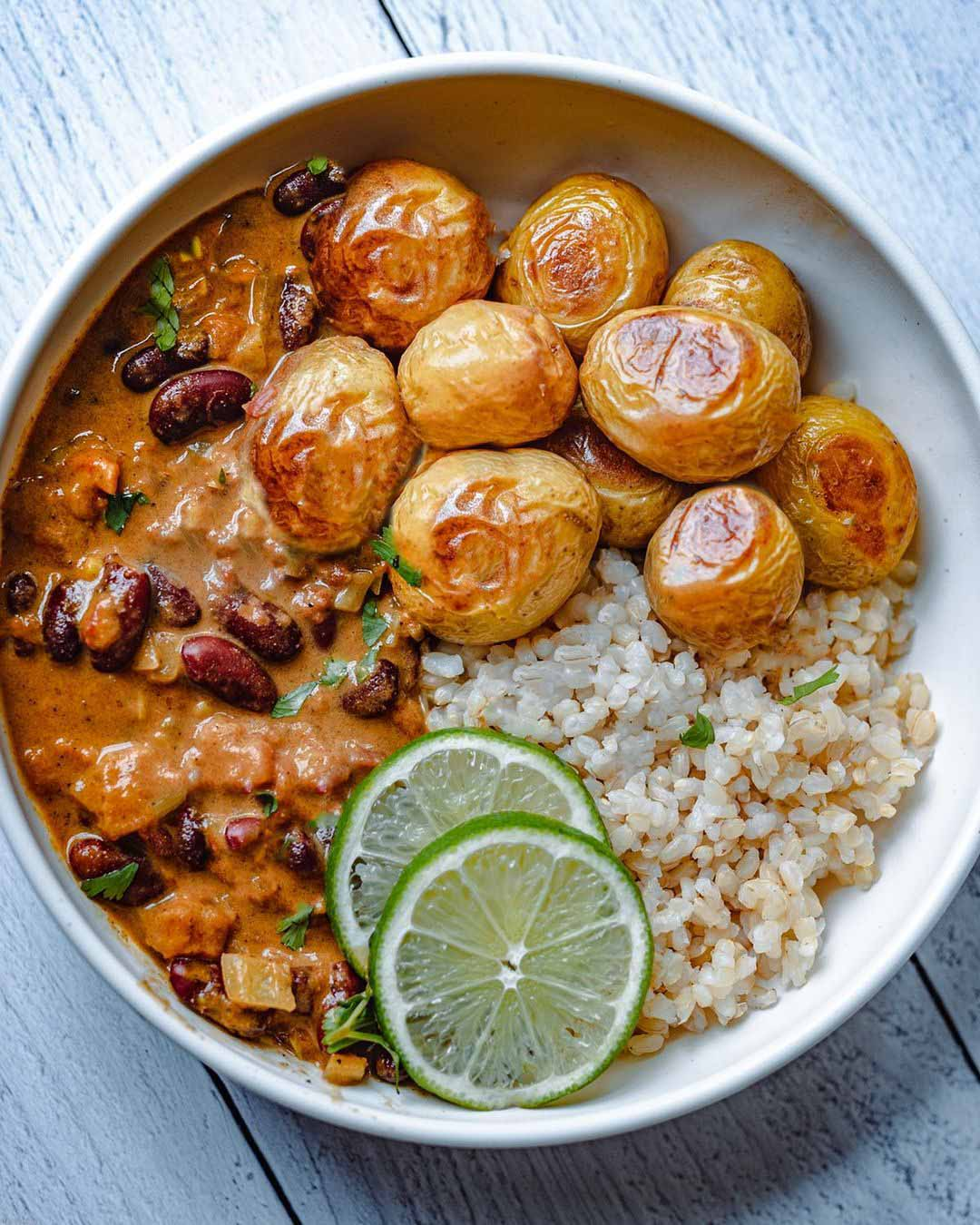 Bean Curry with Roasted Potatoes recipe displayed in a bowl.