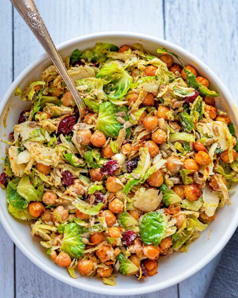 Chickpea & Brussels Vegan Caesar Salad served in a large bowl with spoon.