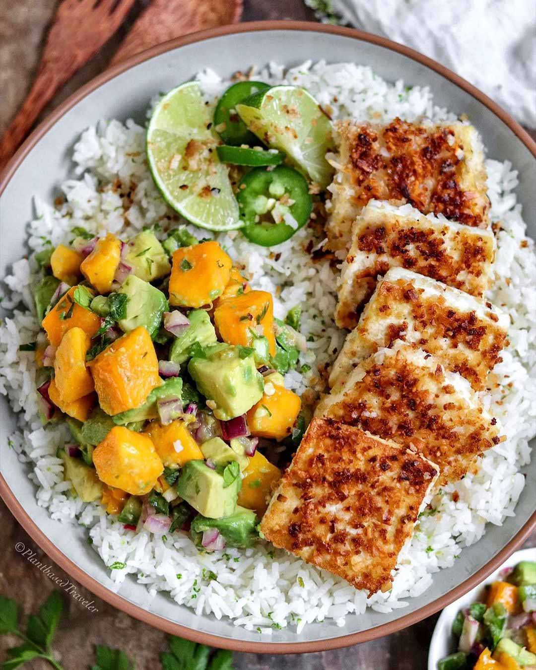 Coconut Panko Crusted Tofu with Mango Avocado Salad recipe served on a plate with rice.