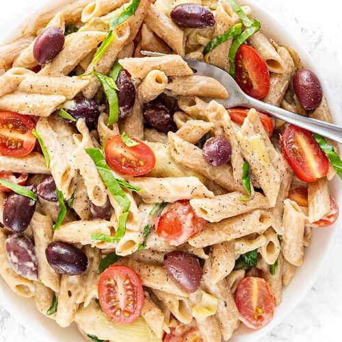Creamy Hummus Pasta recipe displayed in a bowl with spoon.