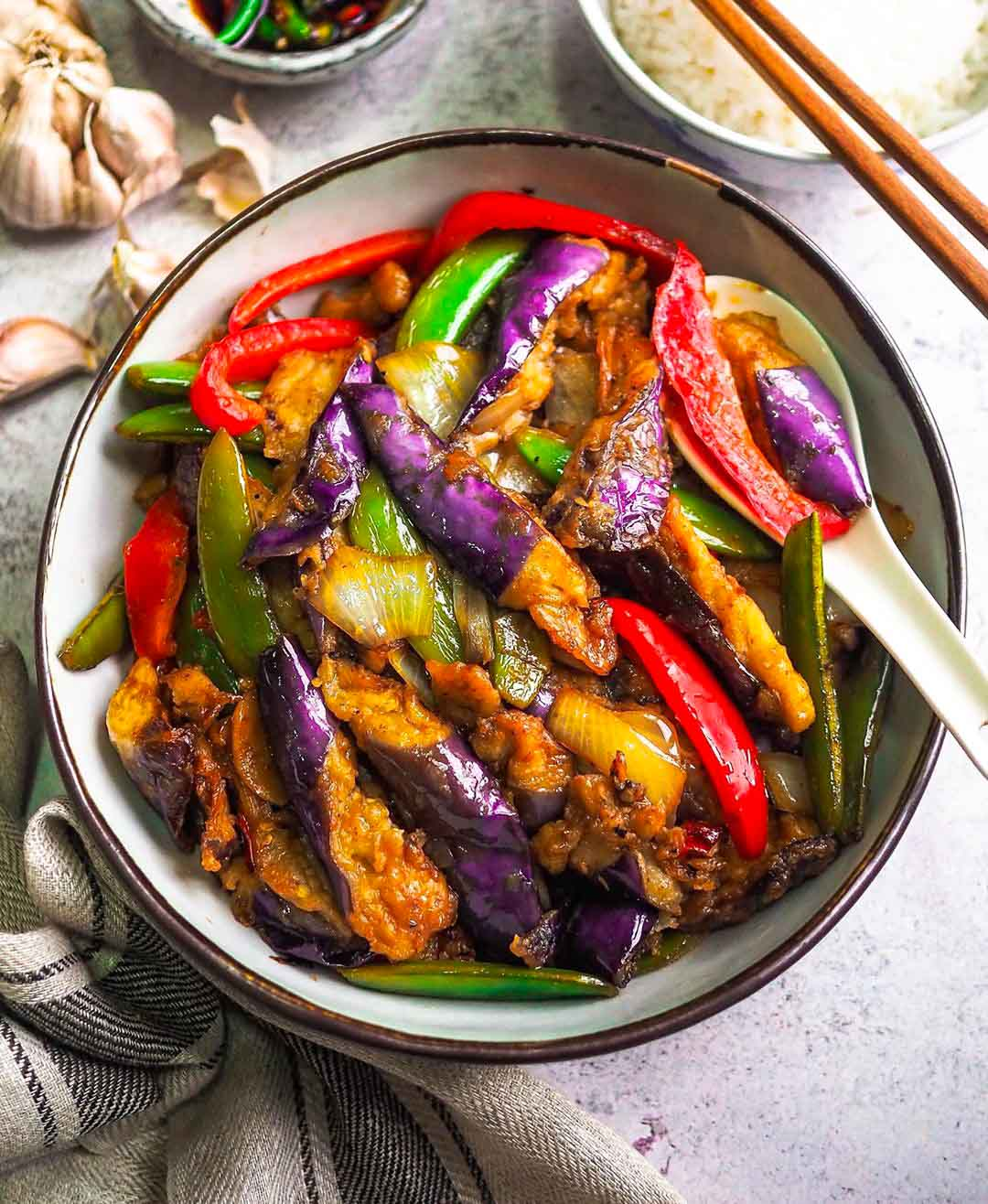 Easy Eggplant Stir Fry recipe served in a bowl with spoon.
