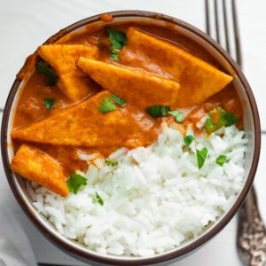 Easy Tofu Masala recipe served in a bowl with fork.