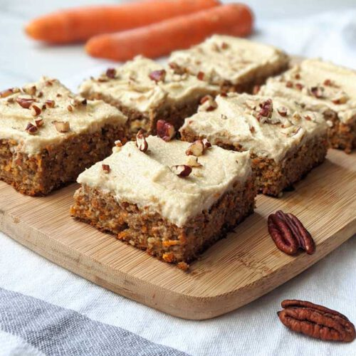 Healthy Vegan Carrot Cake recipe displayed on a wooden plate.