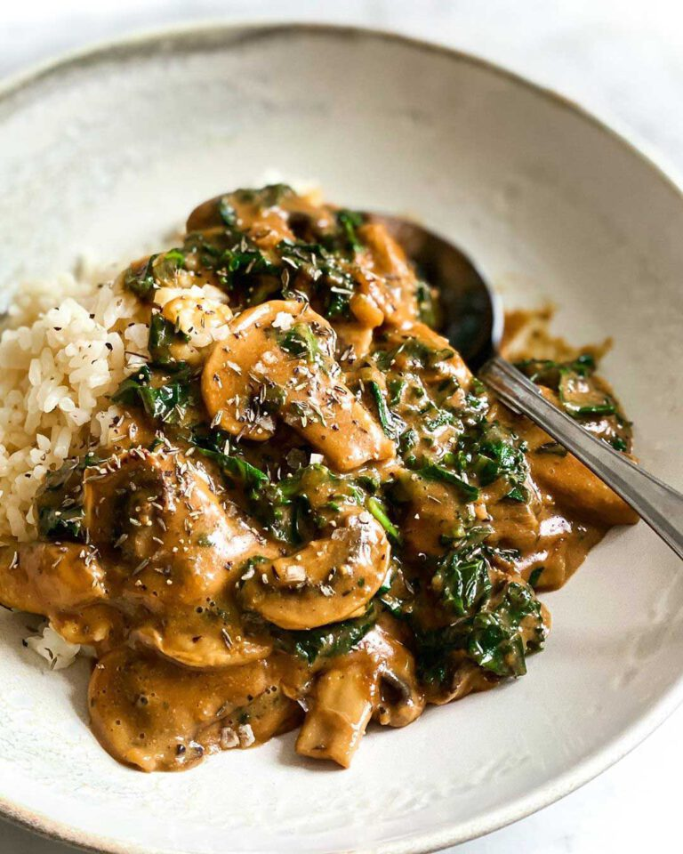 Mushroom & Kale Stroganoff recipes served in a bowl with spoon.
