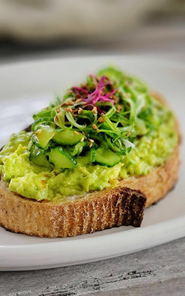 Scallion & Cucumber Avocado Toast recipe displayed on a plate.