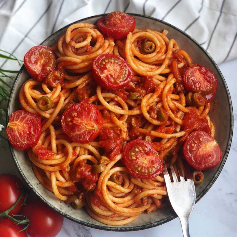 Slow Roasted Cherry Tomato Pasta recipe served in a bowl with spoon.