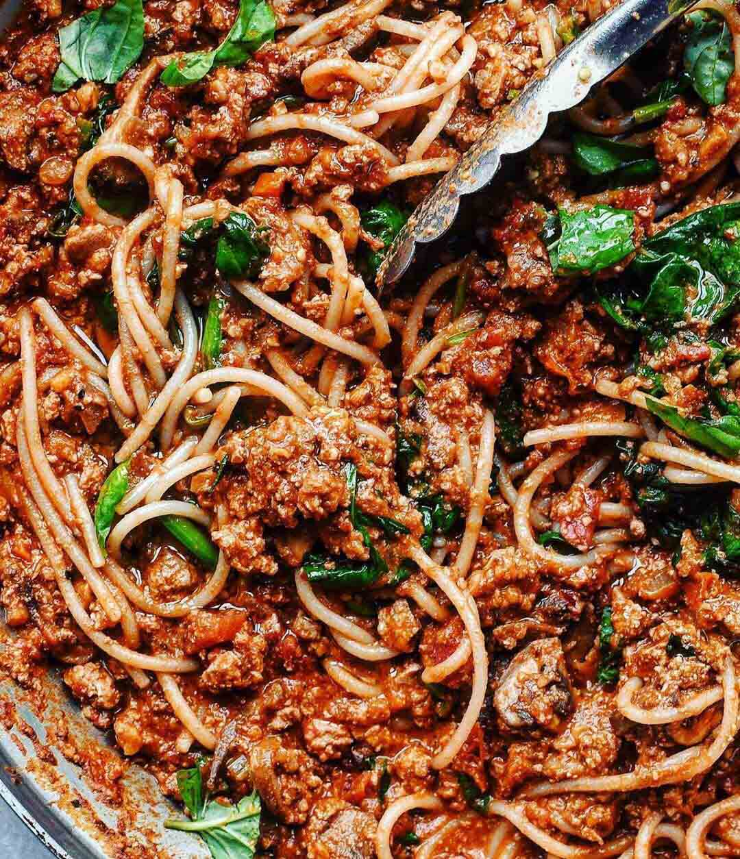 Spaghetti Bolognese with Walnut Tofu Meat recipe displayed in a large pan.
