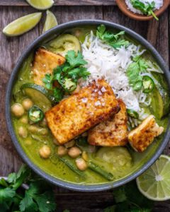 Spicy Coconut Lime Curry with Crispy Marinated Tofu recipe served in a bowl.