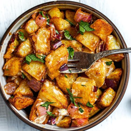The Best Vegan Roasted Potatoes recipe served in a bowl with fork.