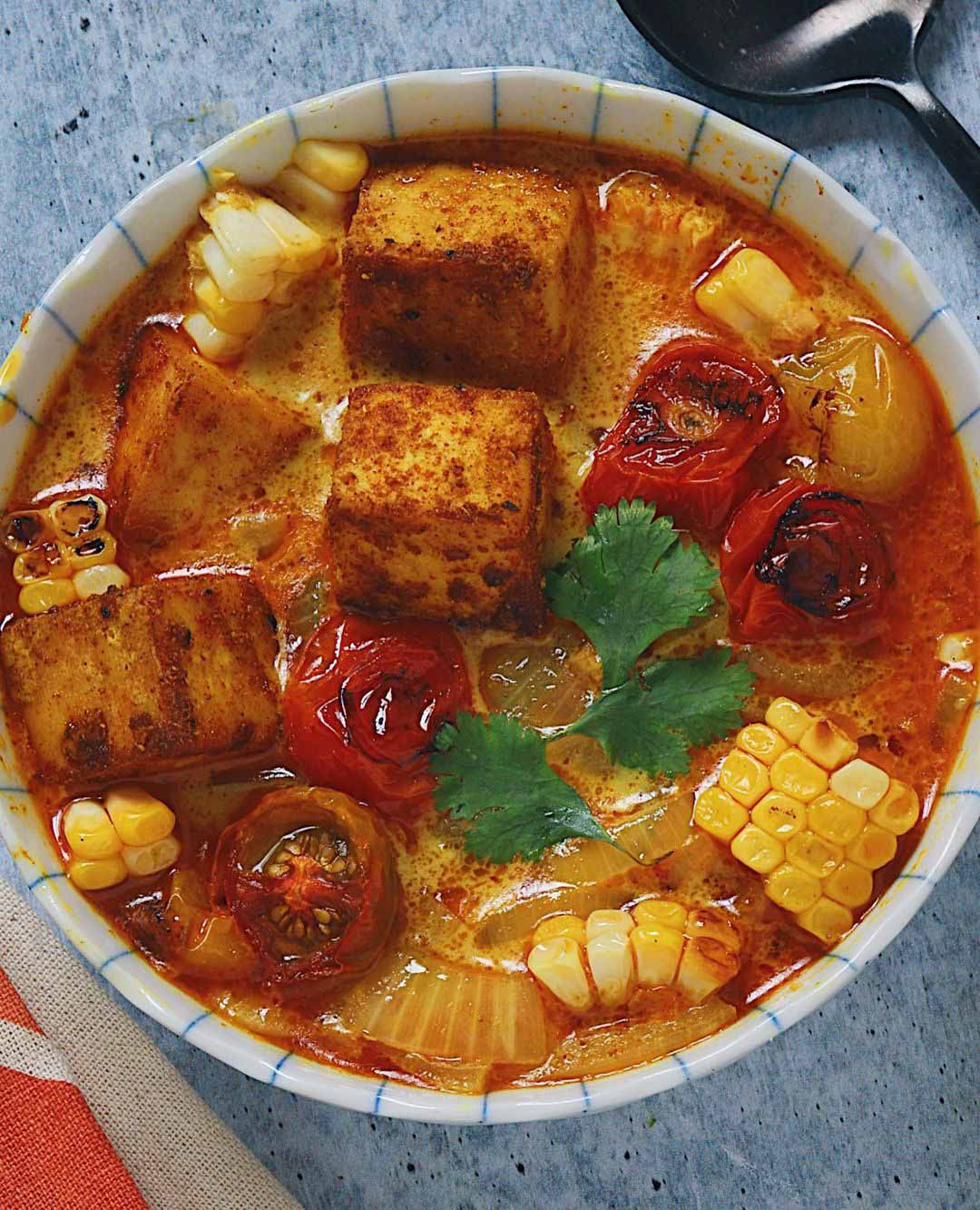 Tofu Curry & Roasted Summer Vegetables recipe served in a bowl.
