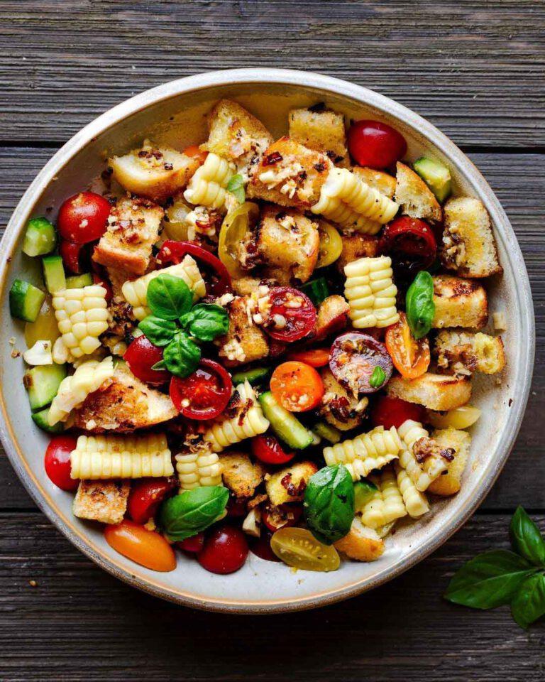 Vegan Corn Panzanella Salad recipe displayed in a bowl.