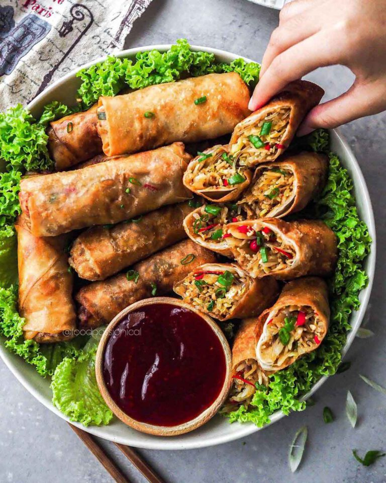 Vegan Fried Spring Rolls served on a plate with dipping sauce.