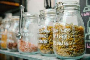 Vegan Pantry Essentials displayed on a shelf.