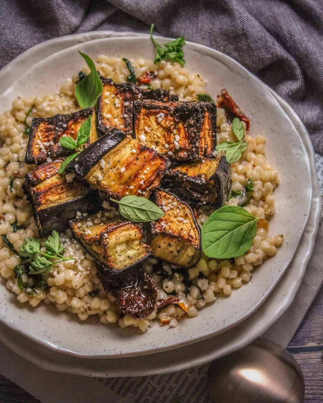 Crispy Roasted Aubergine with Creamy Couscous recipe served on a plate.