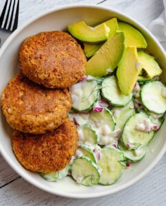 Easy Vegan Chipotle Tofu Burgers recipe served in a bowl with cucumber and avocado.