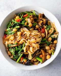 Spicy Eggplant and Kale Fettucine recipe served in a bowl.