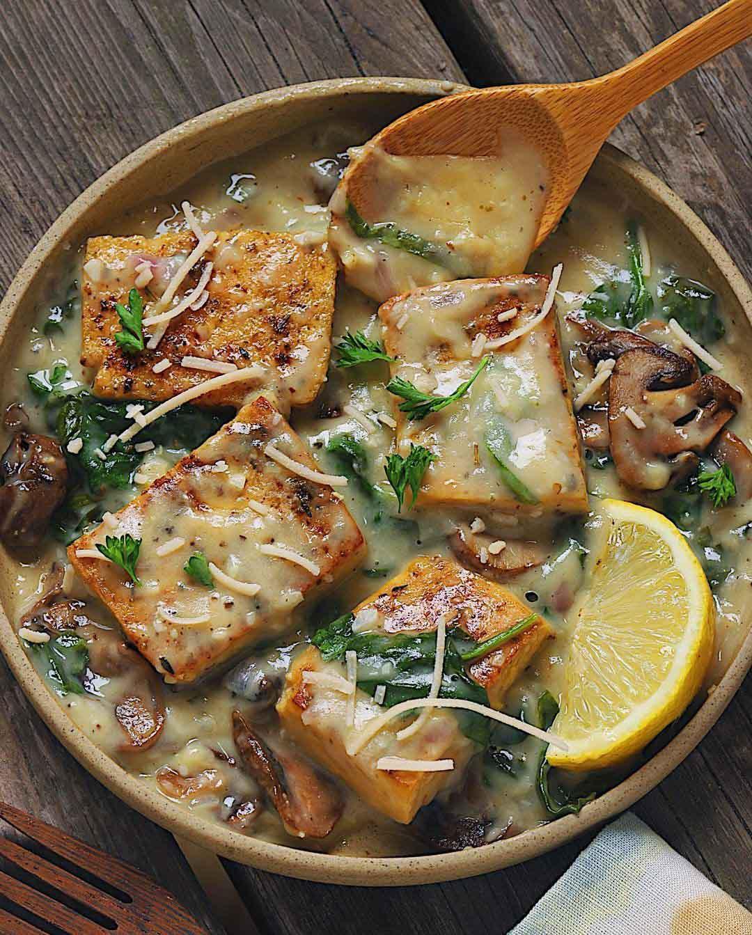 Tofu & Mushroom Cheezy Florentine recipe served in a bowl.