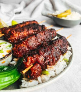 Vegan BBQ Skewers recipe served with rice and dips.