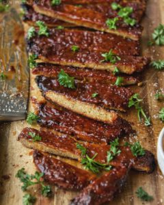 Vegan Barbecue Ribs recipe served on a wooden plate.