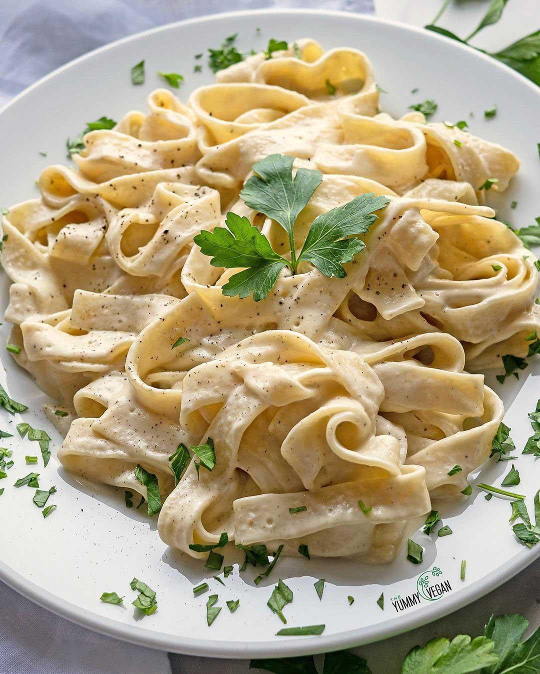 Vegan Fettucine Alfredo recipe served on a plate.