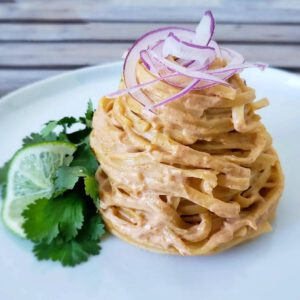 Linguine with Red Curry Cream Sauce recipe served on a plate.