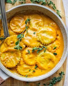 Homemade Vegan Pumpkin Ravioli recipe served in a bowl.