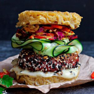 Vegan Ramen Burger with Kimchi Slaw recipe served on a plate.