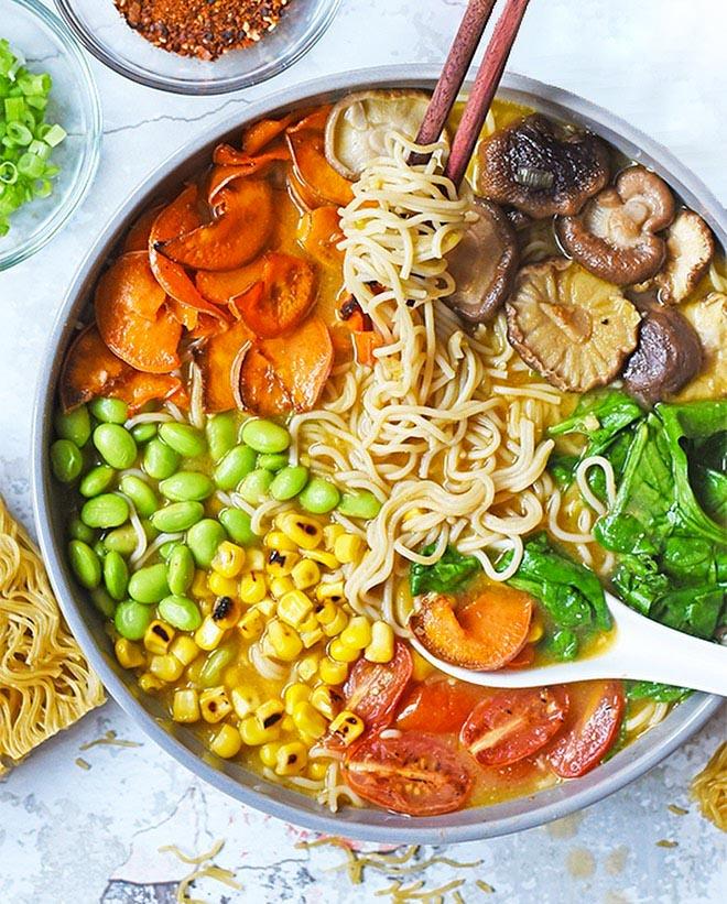 Vegan Veggie Ramen Soup recipes served in a bowl with chopsticks.